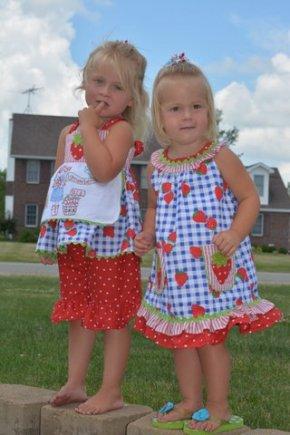 girls in strawberry dresses