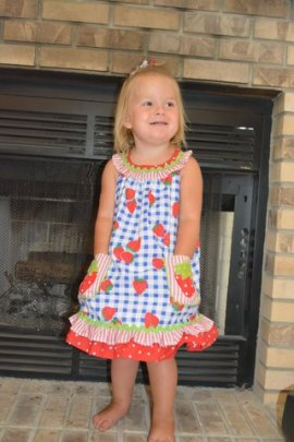 velly in her strawberry dress